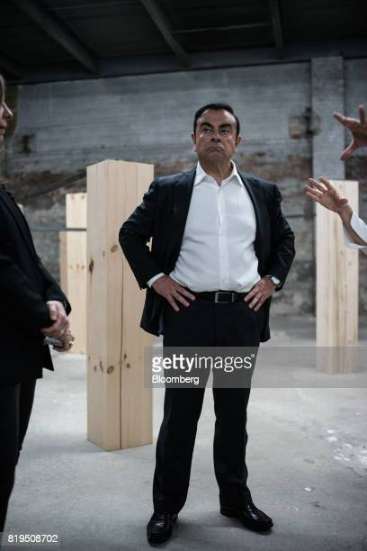 Carlos Ghosn chairman of Renault SAS Nissan Motor Co and Mitsubishi Motors Corp views artwork at the DIA Art Foundation in the Chelsea neighborhood...