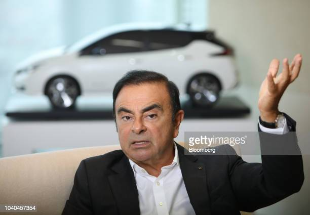 Carlos Ghosn chairman of the alliance between Renault SA Nissan Motor Co and Mitsubishi Motors Corp speaks during an interview at Nissan's...