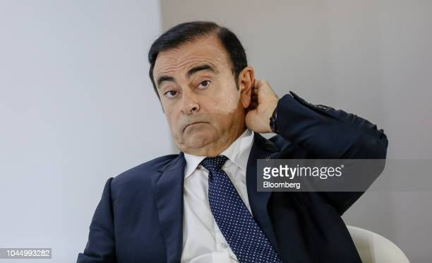 Carlos Ghosn chairman of the alliance between Renault SA Nissan Motor Co and Mitsubishi Motors Corp pauses during a news conference at the Paris...