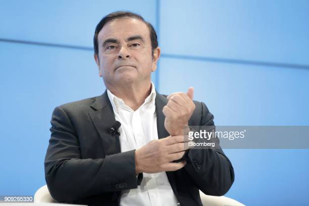 Carlos Ghosn chairman of the alliance between Renault SA Nissan Motor Co and Mitsubishi Motors Corp looks on during a panel session on the opening...