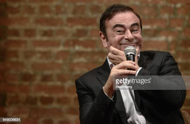 Carlos Ghosn chairman of the alliance between Renault SA Nissan Motor Co and Mitsubishi Motors Corp reacts during an event in Hong Kong China on...