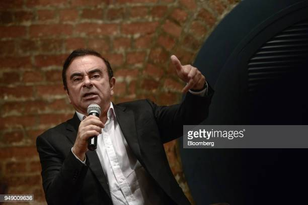 Carlos Ghosn chairman of the alliance between Renault SA Nissan Motor Co and Mitsubishi Motors Corp gestures while speaking during an event in Hong...