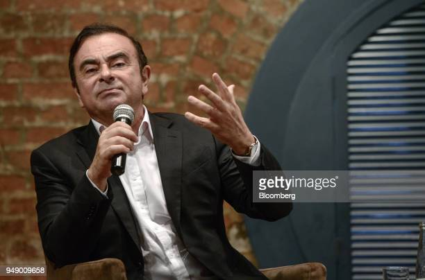 Carlos Ghosn chairman of the alliance between Renault SA Nissan Motor Co and Mitsubishi Motors Corp gestures during an event in Hong Kong China on...