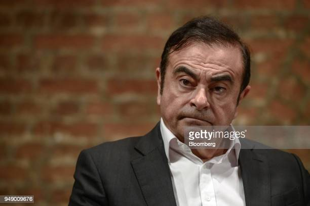 Carlos Ghosn chairman of the alliance between Renault SA Nissan Motor Co and Mitsubishi Motors Corp pauses during an event in Hong Kong China on...