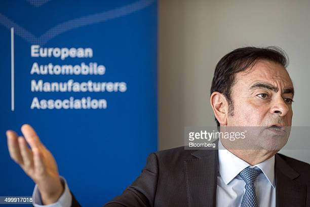 Carlos Ghosn chief executive officer of Nissan Motor Co and Renault SA gestures as he speaks during a news conference in Brussels Belgium on Friday...