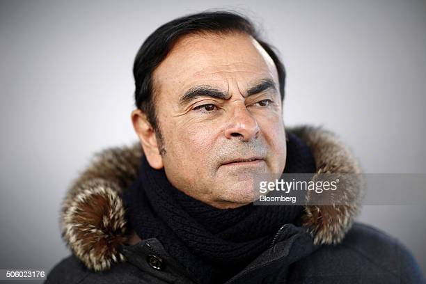 Carlos Ghosn chief executive officer of Nissan Motor Co and Renault SA poses for a photograph following a Bloomberg Television interview in Davos...