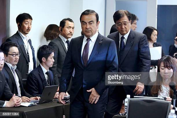 Carlos Ghosn chief executive officer of Nissan Motor Co center and Osamu Masuko chairman and chief executive officer of Mitsubishi Motors Corp center...
