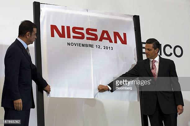 Carlos Ghosn chief executive officer of Nissan Motor Co left and Enrique Pena Nieto Mexico's president prepare to unveil a plaque during a ceremony...