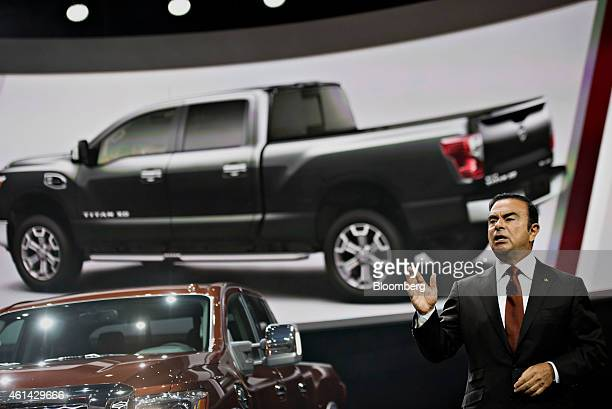 Carlos Ghosn chief executive officer of Nissan Motor Co speaks during the unveiling of the 2016 Nissan Titan XD truck at the 2015 North American...