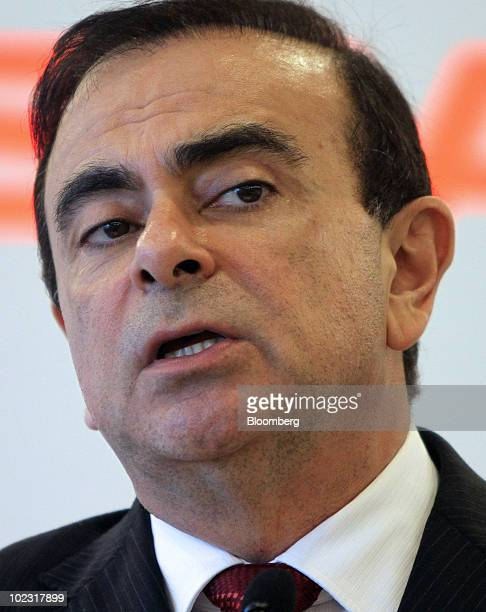Carlos Ghosn chief executive officer of Nissan Motor Co speaks to the media during a roundtable following the company's annual shareholders' meeting...
