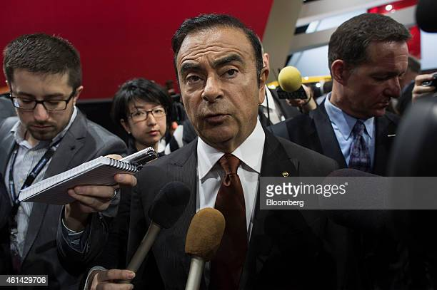 Carlos Ghosn chief executive officer of Nissan Motor Co speaks to the media following the unveiling of the 2016 Nissan Titan XD truck during the 2015...