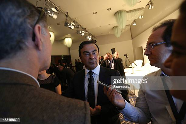 Carlos Ghosn chief executive officer of Renault SA and Nissan Motor Co speaks to journalists following a news conference at the IAA Frankfurt Motor...