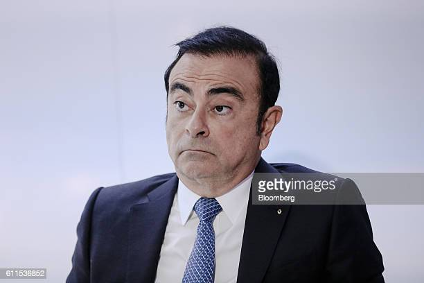 Carlos Ghosn, chief executive officer of Renault SA and Nissan Motor Co., looks on during a news conference on the second press day of the Paris...