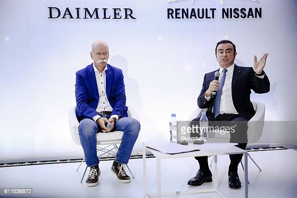 Carlos Ghosn, chief executive officer of Renault SA and Nissan Motor Co., right, gestures whilst speaking beside Dieter Zetsche, chief executive...