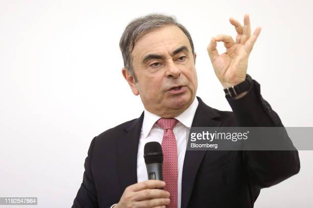 Carlos Ghosn, former chief executive officer of Nissan Motor Co. And Renault SA, gestures as he speaks to the media at the Lebanese Press Syndicate...