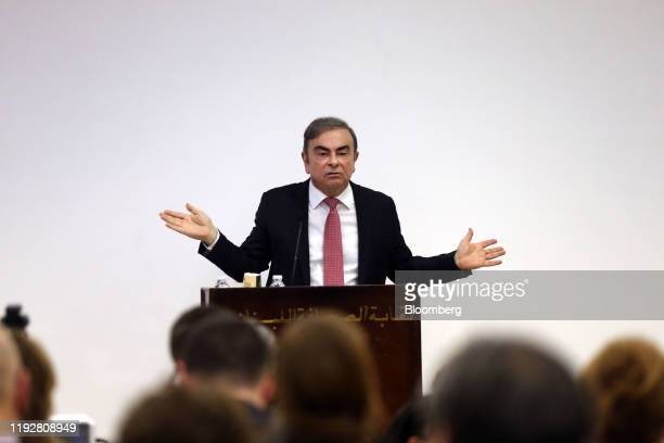 Carlos Ghosn former chief executive officer of Nissan Motor Co and Renault SA gestures as he speaks to the media at the Lebanese Press Syndicate in...