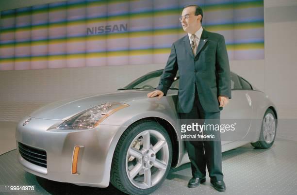 Carlos Ghosn PDG de Nissan au salon de l'automobile à Tokyo