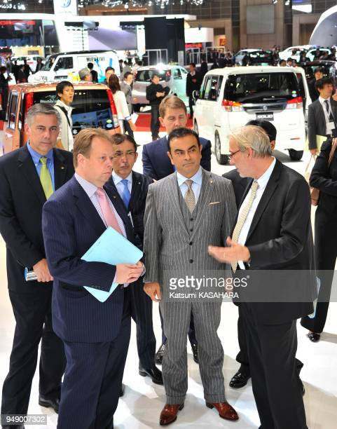 Carlos Ghosn president and CEO of Nissa second from right inspects a hall after his presentation during a press preview day of the Tokyo Motor Show...