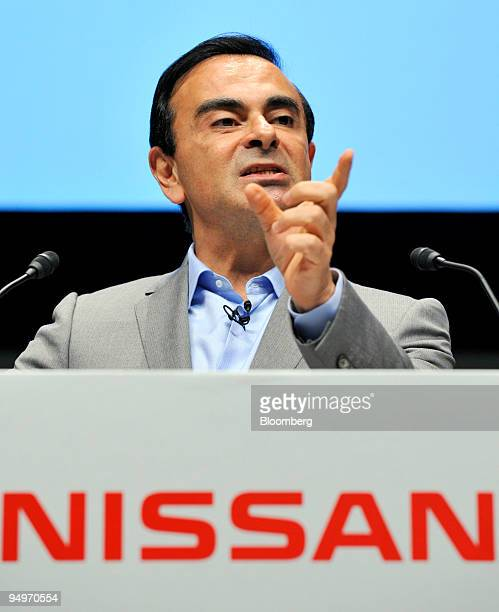 Carlos Ghosn president and chief executive officer of Nissan Motor Co speaks after introducing the Leaf electric vehicle during the inauguration...