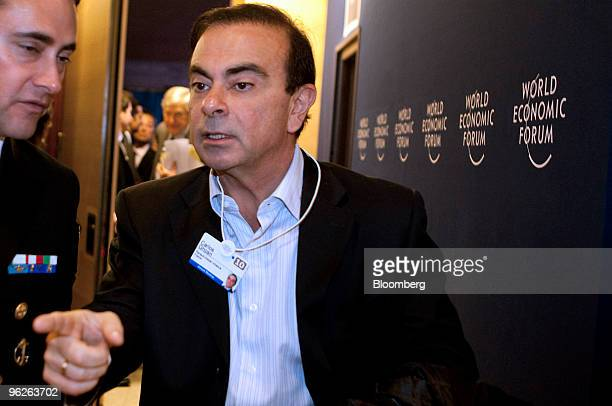 Carlos Ghosn president and chief executive officer of Nissan Motor Co leaves following a session on day three of the 2010 World Economic Forum annual...