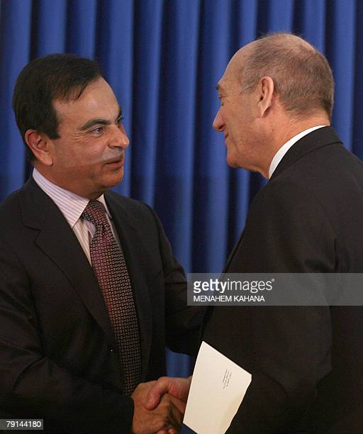 Carlos Ghosn President of French company RenaultNissan shakes hands with Israeli Prime Minister Ehud Olmert after a ceremony during which they...