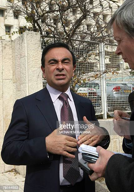 Carlos Ghosn President of French company RenaultNissan speaks to an AFP reporter after a ceremony in which Israeli investor Shai Agassi and...