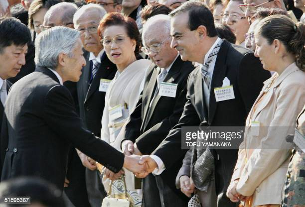 Carlos Ghosn president of Japan's auto giant Nissan Motor and his wife Rita are welcomed by Japanese Emperor Akihito during the annual autumn garden...