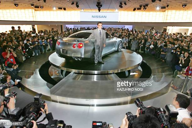 Carlos Ghosn president of Japan's Nissan Motor Co poses next to the company's concept car GTR PROTO to be launched worldwide in 2007 during a press...