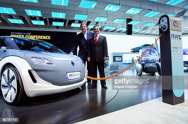 Carlos Ghosn the President and CEO of Renault and Juergen Grossmann CEO of German energy giant RWE pose next to a charging device for electric cars...