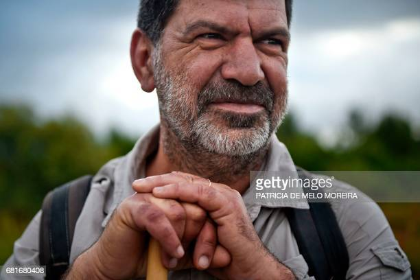 Carlos Gil poses for a photo on the morning he started his walk to Fatima in Cascais outskirts of Lisbon on May 5 2017 Carlos Gil is a payeroff of...