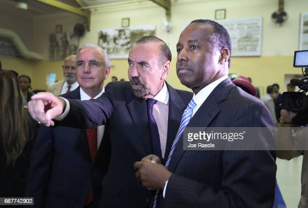 Carlos Gimenez mayor of MiamiDade Jorge Perez CEO Related Urban Group and US Housing and Urban Development Secretary Ben Carson stand together during...
