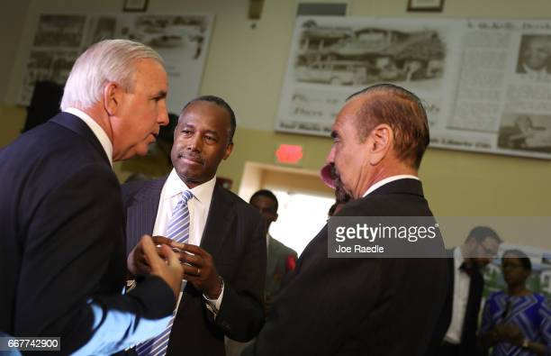 Carlos Gimenez mayor of MiamiDade US Housing and Urban Development Secretary Ben Carson and Jorge Perez CEO Related Urban Group stand together during...