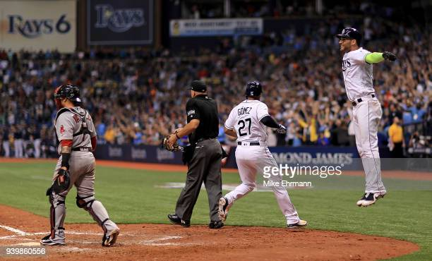Carlos Gomez and Kevin Kiermaier of the Tampa Bay Rays react after scoring on a triple by Denard Span in the eighth inning during a game against the...