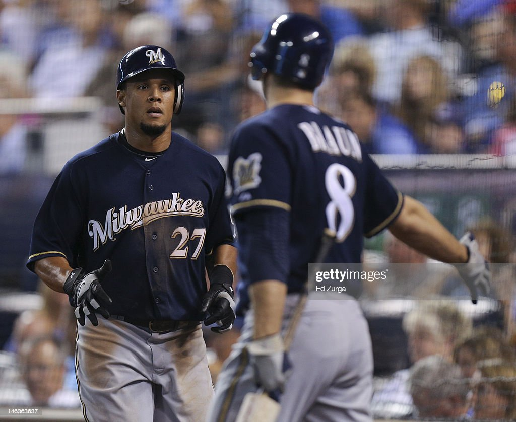 Carlos Gomez #27 is congratulated by Ryan Braun #8 of the Milwaukee Brewers after scoring on a Cody Ransom single during an interleague game against the Kansas City Royals at Kauffman Stadium on June 14, 2012 in Kansas City, Missouri.