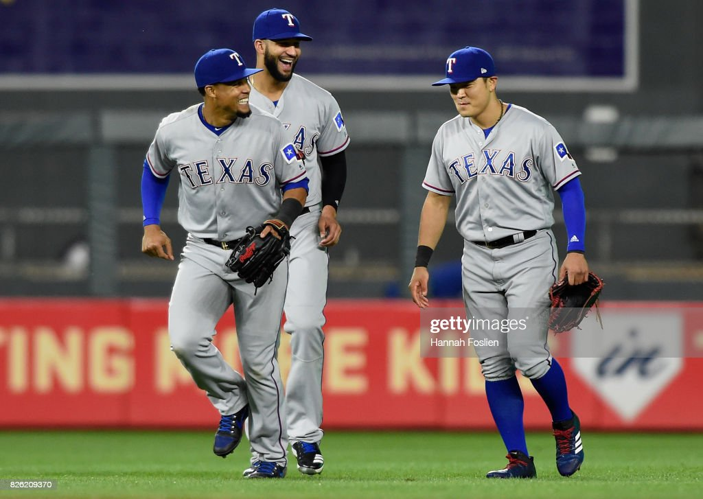 Carlos Gomez #14, Nomar Mazara #30 and Shin-Soo Choo #17 of the Texas Rangers celebrate winning against the Minnesota Twins after the game on August 3, 2017 at Target Field in Minneapolis, Minnesota. The Rangers defeated the Twins 4-1.