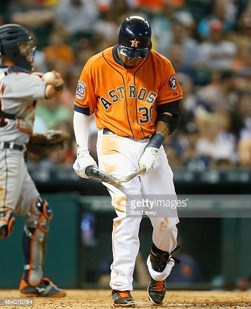Carlos Gomez of the Houston Astros breaks his bat over his leg after striking out in the eighth inning against the Detroit Tigers at Minute Maid Park...