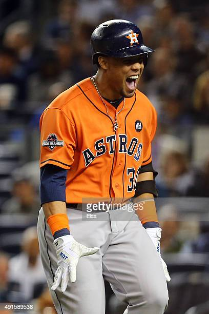 Carlos Gomez of the Houston Astros celebrates after hitting a solo home run in the fourth inning against Masahiro Tanaka of the New York Yankees...