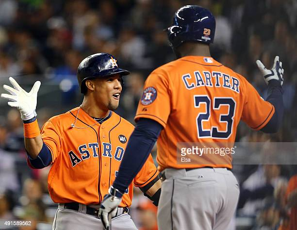 Carlos Gomez of the Houston Astros celebrates with teammate Chris Carter after hitting a solo home run in the fourth inning against Masahiro Tanaka...