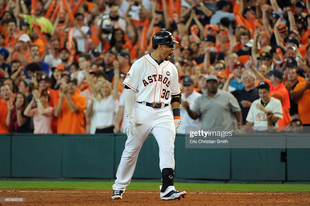 Carlos Gomez #30 of the Houston Astros reacts after hitting an RBI single in the sixth inning against the Kansas City Royals in game three of the American League Division Series at Minute Maid Park on October 11, 2015 in Houston, Texas.