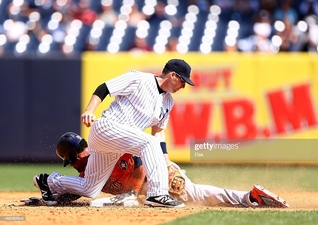 Carlos Gomez #30 of the Houston Astros steals second base in the sixth inning as Stephen Drew #14 of the New York Yankees tries to make the tag on August 26, 2015 at Yankee Stadium in the Bronx borough of New York City.