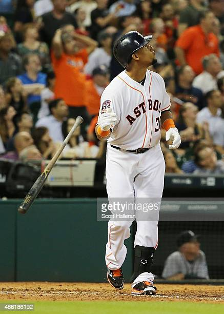 Carlos Gomez of the Houston Astros watches a sacrifice fly to left field in the third inning of their game against the Seattle Mariners at Minute...
