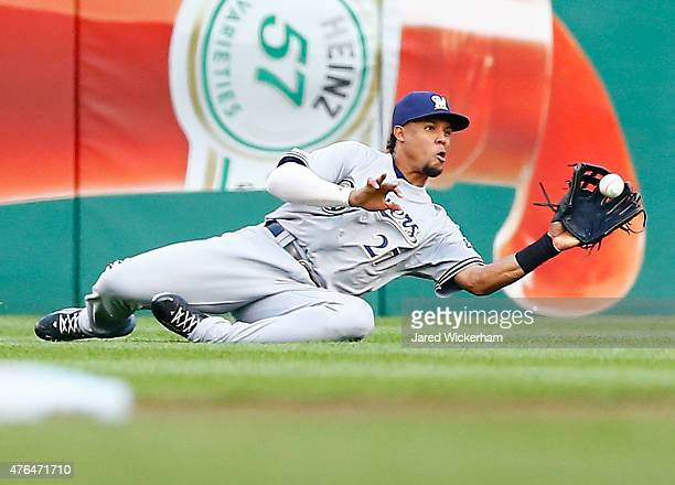 Carlos Gomez of the Milwaukee Brewers catches a ball in center field in the third inning against the Pittsurgh Pirates during the game at PNC Park on...