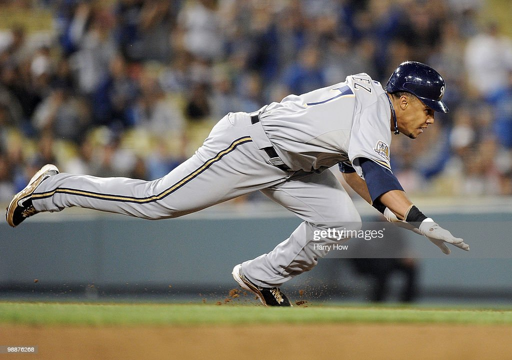 Carlos Gomez #27 of the Milwaukee Brewers dives back into 2nd base during a run down in the eighth inning against the Los Angeles Dodgers at Dodger Stadium on May 5, 2010 in Los Angeles, California.