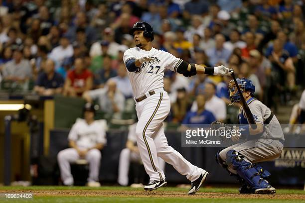 Carlos Gomez of the Milwaukee Brewers doubles in the bottom of the fifth inning scoring Ryan Braun and Aramis Ramirez against the Los Angeles Dodgers...