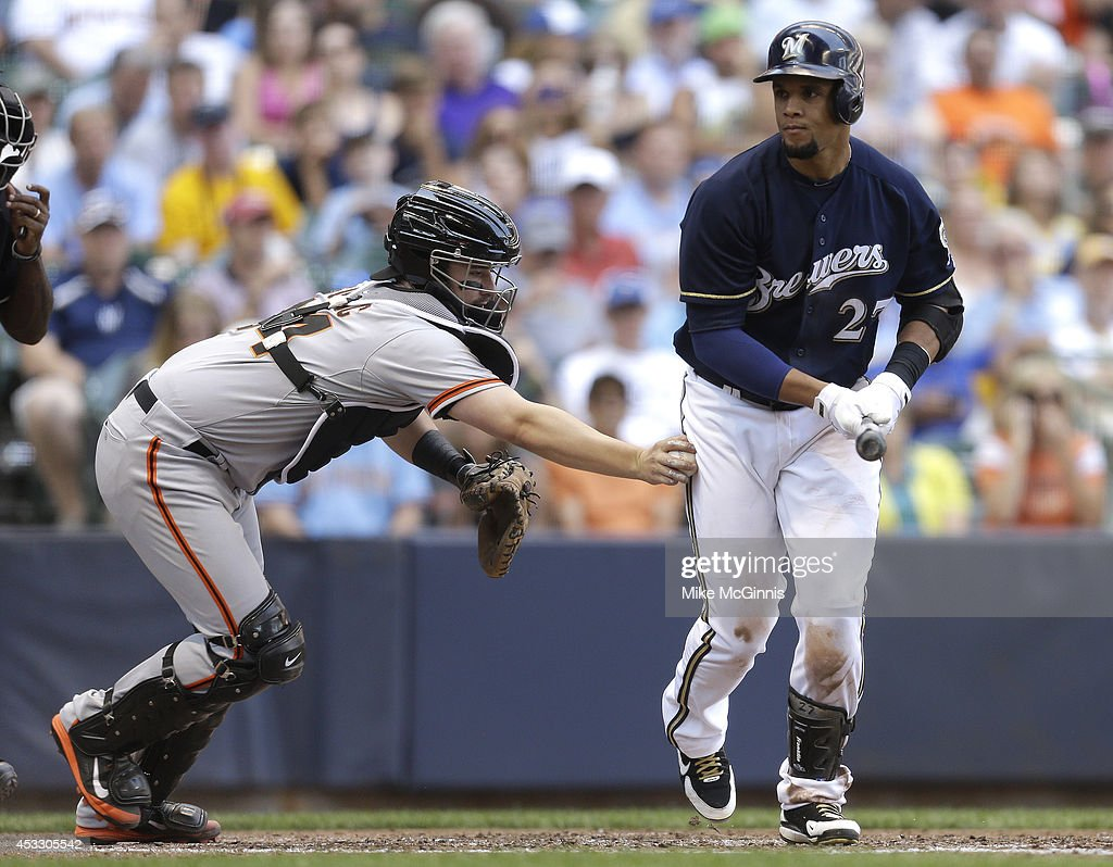 Carlos Gomez #27 of the Milwaukee Brewers gets tagged out from Andrew Susac #34 of the San Francisco Giants after swing at strike three during the bottom of the fifth inning at Miller Park on August 07, 2014 in Milwaukee, Wisconsin.