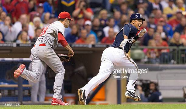 Carlos Gomez of the Milwaukee Brewers is chased and tagged out by Joe Kelly of the St Louis Cardinals in the sixth inning at Miller Park on September...