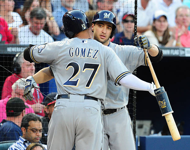 C. Gomez and R. Braun of the Milwaukee Brewers