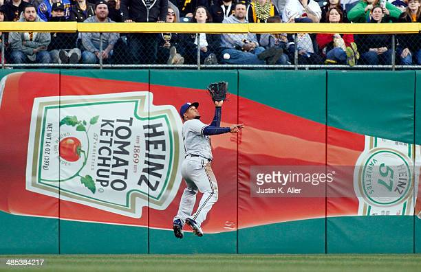 Carlos Gomez of the Milwaukee Brewers makes a catch in center field in the first inning against the Pittsburgh Pirates during the game at PNC Park...