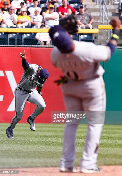 Carlos Gomez of the Milwaukee Brewers reacts after making a catch in the ninth inning to end the game against the Pittsburgh Pirates during the game...