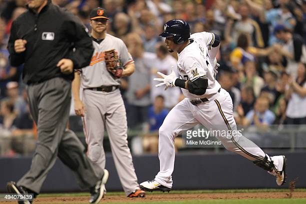 Carlos Gomez of the Milwaukee Brewers runs the bases after hitting a three run homer in the bottom of the third inning against the Baltimore Orioles...
